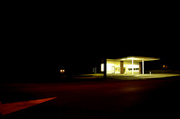 Abandoned Gas Station at Night